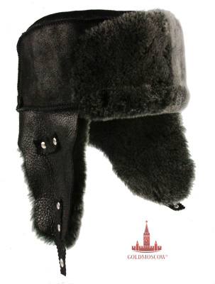 "Cap ear flaps ""Tsigeykovaya black""  Winter hat, made of fur with big ear flaps. Hat can be worn both in the off-season, and in severe frosts in winter. Very warm dense fur is able to warm in any weather, with a high quality manufacture of fur makes it soft and delicate structure of the touch that creates some additional comfort when using this hat with earflaps. The system reliable rivets and locks makes it easy to customize the shape of a hat to the features of your head. Leather cap makes practical and convenient in everyday use it. Perfect for the upcoming period of frost."