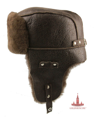 "Cap ear flaps ""Tsigeykovaya brown""  Excellent soft and warm winter hat with leather uppers. Thick thick fur gray-brown color perfectly harmonizes with the molasses brown leather headgear securely stitched strong silk thread. Cap has a great ear valve with metal rivets, allowing easy and convenient to fasten them on the neck when worn during the cold period of time. Practicality caps due not only to keep its shape under all storage conditions, and climatic characteristics at the time of carrying in wet snow conditions."