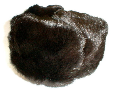 "Hat ""Black rabbit fur hat""  Fur hat black rabbit fur. Fur has a characteristic soft and silky properties. Warm hat is made in the form of a traditional Russian winter hat with folding cervical valves. Good and inexpensive headdress during the cold and harsh winter."