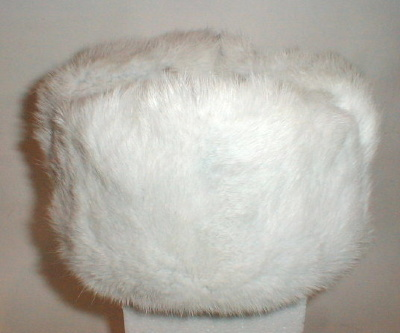"Hat ""earflaps White Rabbit""   Warm winter hat from fur are solid enough rare white rabbit. The soft texture of the fur and beautiful appearance, hat with earflaps will make your favorite hat in the winter time."