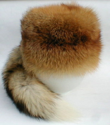 "Hat ""Fox""  Warm, round beautiful bright cap of fox fur. Thanks to a soft fluffy texture warms in the cold period of time.  The long nap fur helps protect against moisture and wet snow conditions. To cap mounted decorative fox's tail, which makes it unique and beautiful headdress"