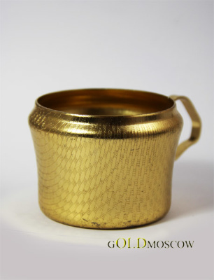 "Holder ""Net""  The original aluminum cup holder in the shape of a traditional old mug. The surface is decorated with cupholders small asymmetrical ornament in the form of a grid and resistant anodized plated ""gold-plating"". Such holders are manufactured in vintage shops in Tula, Moscow Province, in Warsaw is part of the Russian Empire. Holder looks great, complete with carved crystal glass of tea. A great gift for those who appreciate the traditions of Russian tea."