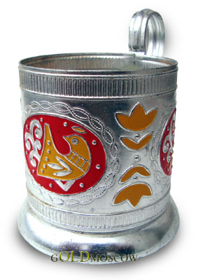 "Holder ""cockerel""  The beautiful and original holder made of aluminum filled with colorful fragmented artistic decor. Comfortable handle, beautiful bas-relief pattern in the form of old stylized images of birds, a wide polished bearing ring embody the holder is a great gift for those who appreciate the traditions of Russian tea."