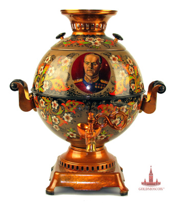 "Electric samovars ""Holiday""  It is enough to surround all electric samovar Tula factory production. The original author's signature samovar, thematically intersecting with the celebration of Victory Day in May. On the front surface of the samovar is made with the help of artist miniaturist portrait of Marshal of the Soviet Union - Georgy Zhukov. Soft pastel brown and golden background pattern harmoniously resonates with openwork and skillfully executed floral ornaments, crowned May primrose flowering trees, passing all the touching and festive spring mood. The samovar is a great gift not only for war veterans, but also for any decent man who appreciates the history of our state. Samovar has a stable, rectangular pan, stylized antique samovars base, strong and comfortable side grips and a wide burner for the location of her large teapot that can drink its aroma big and friendly company of family and friends. Volume 5 liter samovar."