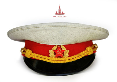 "Cap ""Suvorov""  The white linen cap casual summer uniforms cadets, students of military music schools and pupils of special boarding schools. History of Suvorov schools begins in 1943 and is basically defined as the prototype of the pre-revolutionary Cadet schools, which students become orphans of fallen soldiers during World War II, life priorities which was to become the experienced officers of the Soviet army. One of the first cadets were the sons of famous regiments Vanya Pohomov Pasha Ragulin, Ivan Sergienko, who had a recommendation of Marshal Georgy Zhukov, who loved to wear to the article was a white cap cadets."